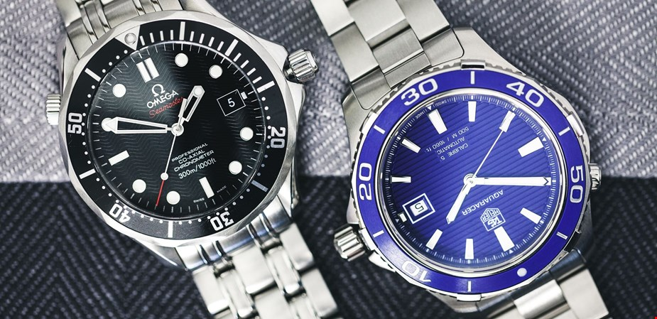 omega seamaster professional co axial black dial tag heuer aquaracer calibre 5 blue dial