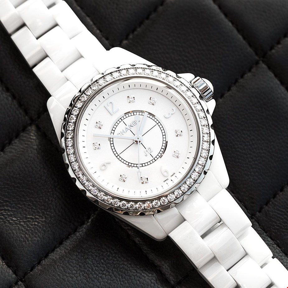 de2e431d934a Xupes pre-owned Chanel J12 white ceramic placed on a Chanel classic double  flap lambskin