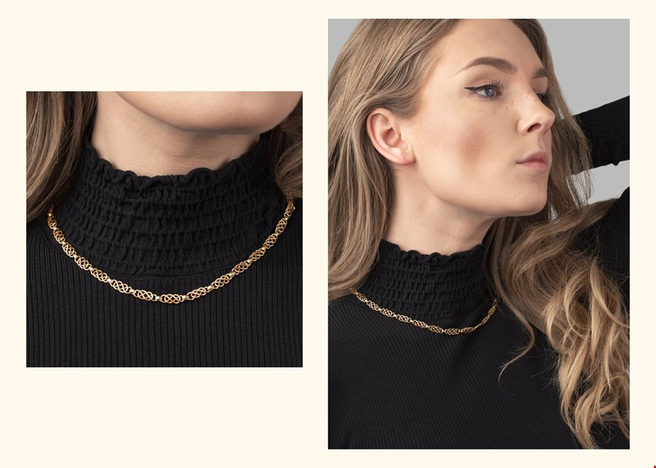 vintage georg jensen yellow gold link necklace worn with a black roll neck jumper