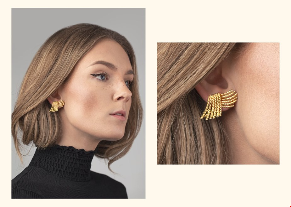 pre owned tiffany and co gold rope earrings worn with a black roll neck jumper