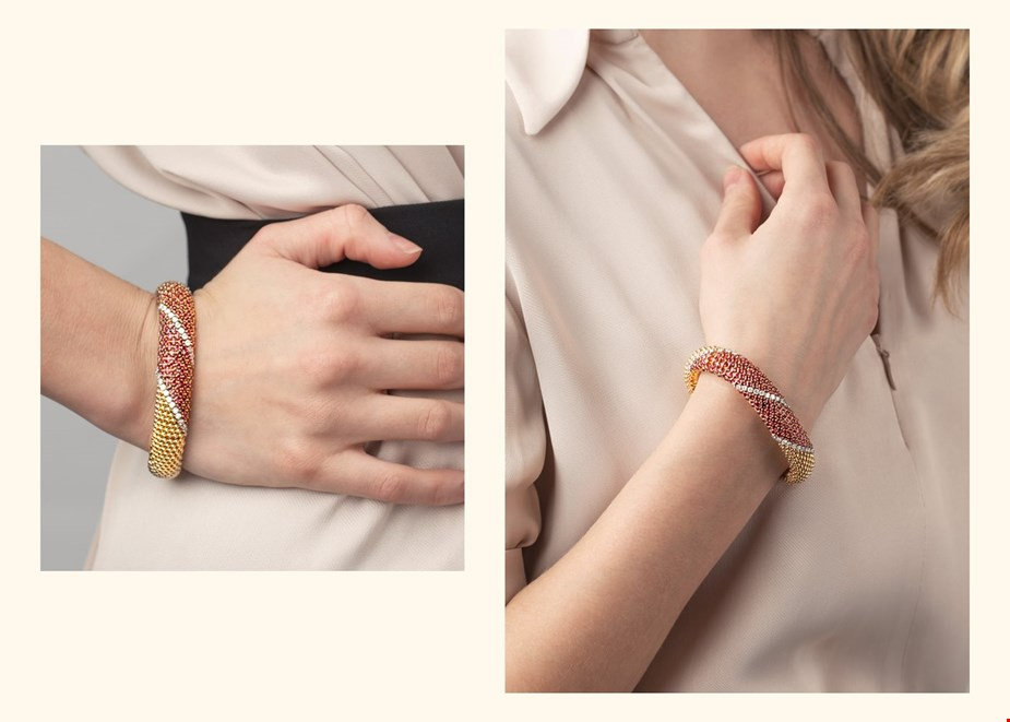 van cleef and arpels diamond and ruby bracelet worn on a model wearing a beige dress