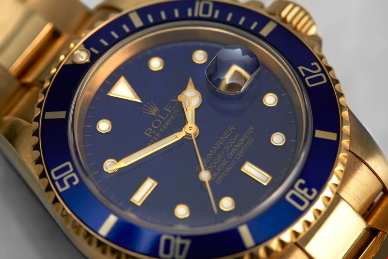 xupes pre-owned rolex submariner yellow gold lapis dial