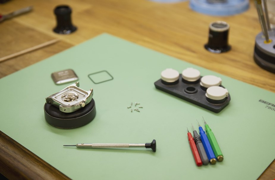 cartier santos 100 open caseback in a workshop