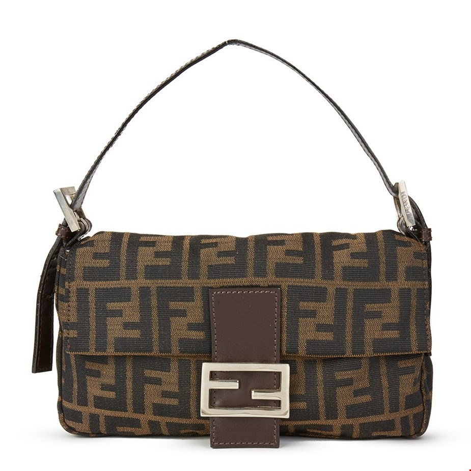 439dd5447ea98a Fendi's Baguette bag was named in such a way because it was designed to fit  comfortably under the arm, much like how the French were seen carrying  their ...